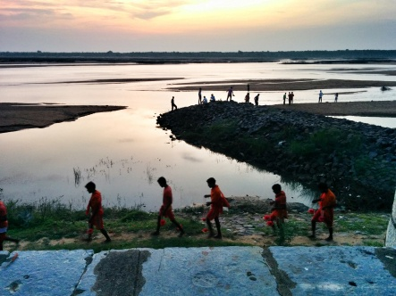 The Mahanadi at sunset, the Shiva bhakts carrying water from the sacred river for the evening puja in the Gandeshwar Temple